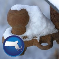 massachusetts a rusty, snow-covered trailer hitch