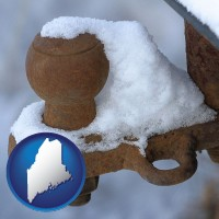 maine a rusty, snow-covered trailer hitch