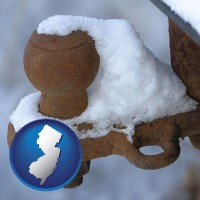 new-jersey a rusty, snow-covered trailer hitch