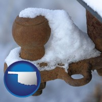 oklahoma a rusty, snow-covered trailer hitch