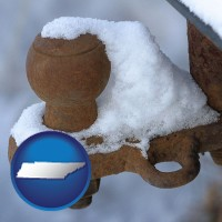 tennessee a rusty, snow-covered trailer hitch
