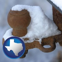 texas a rusty, snow-covered trailer hitch