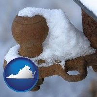 virginia a rusty, snow-covered trailer hitch