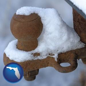 a rusty, snow-covered trailer hitch - with Florida icon