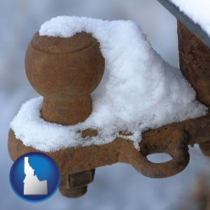 a rusty, snow-covered trailer hitch - with Idaho icon