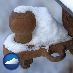 a rusty, snow-covered trailer hitch - with Kentucky icon