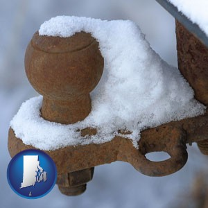 a rusty, snow-covered trailer hitch - with Rhode Island icon