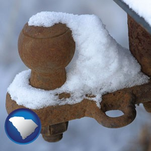 a rusty, snow-covered trailer hitch - with South Carolina icon
