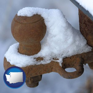 a rusty, snow-covered trailer hitch - with Washington icon