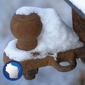 a rusty, snow-covered trailer hitch - with Wisconsin icon